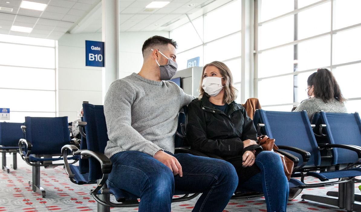 Couple sitting in the airport