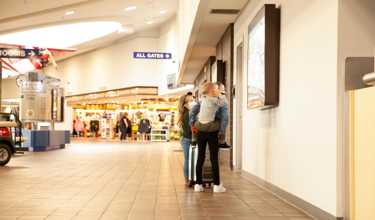 kids in airport terminal